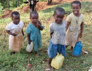 Children collecting water from a borehole.
