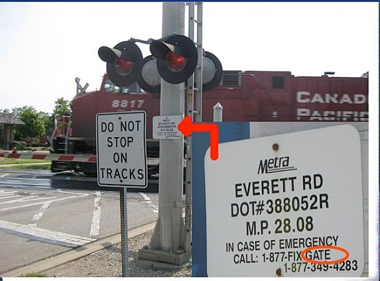 In West Lake Forest, the line is dispatched by Metra and the signs are on the crossing gates.