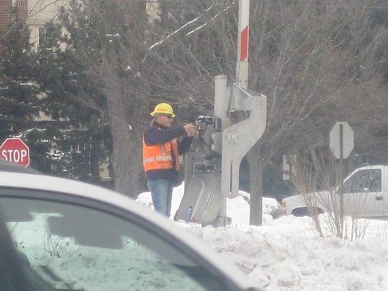 Signal man repairing pedestrian gate ...