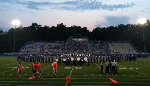 Lake Forest varsity football at the start of the first game of the 2014-15 season; photo by Kevin Reitman.
