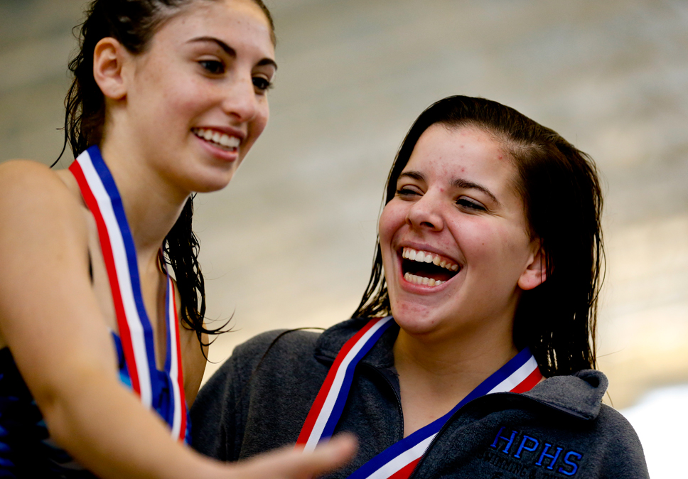 Happy, happy: Highland Park High School's Erin Cullather (right) hugs teammate Avery Spitz following the diving competition at the CSL North Meet. Photo by Joel Lerner