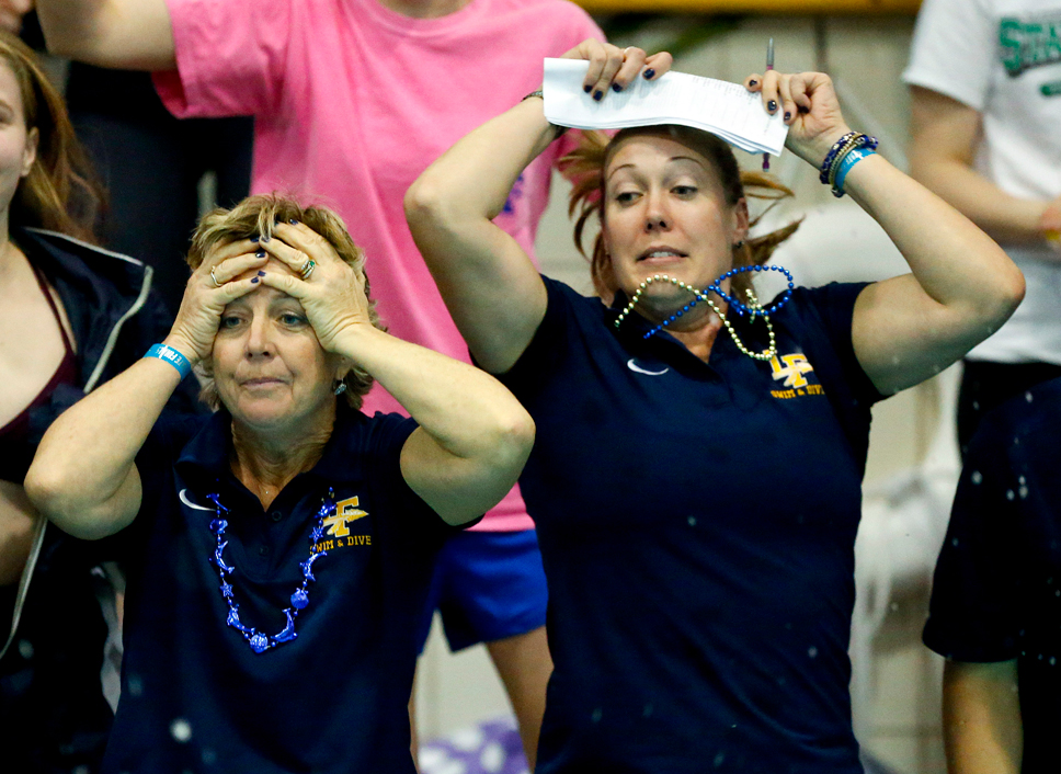 LFHS coaches react to a race at the state meet.
