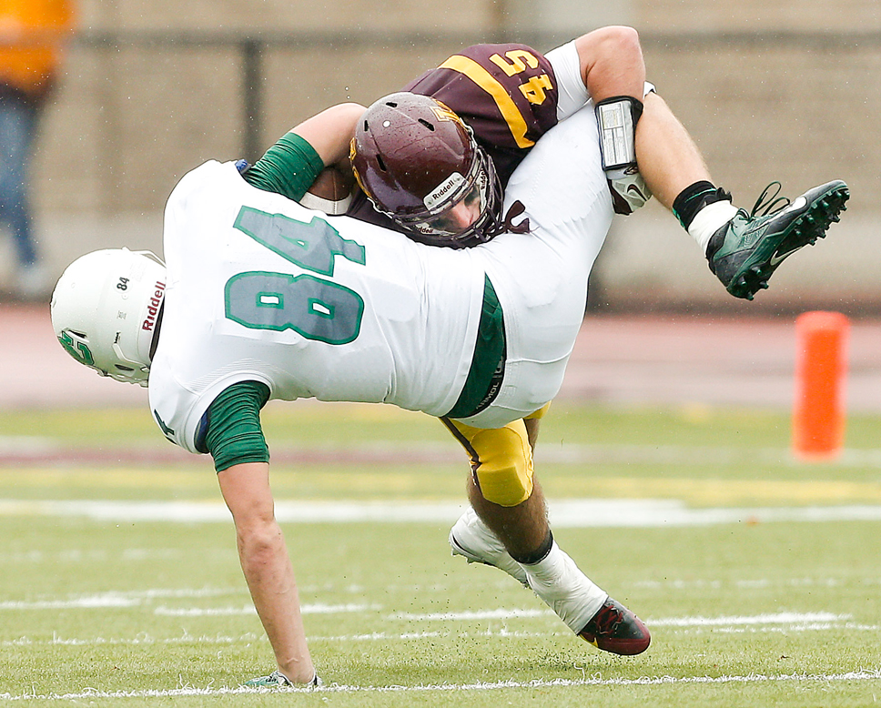 Loyola Academy's Brian O'Brien comes up with a textbook tackle against a Providence wide receiver in earlier action this fall. Photo by Joel Lerner.