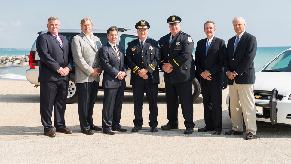 Terry Rozdolsky, Paul Burt, Steven Esposito, Lake Forest Chief of Police James Held, Lake Forest Commander Rob Copeland, Jay McAveeney, and Rick Price have helped launch the Lake Forest Police Foundation. Photo by Jim Prisching