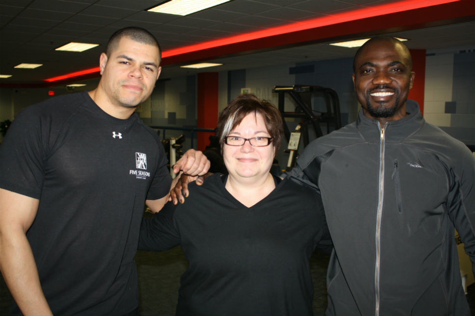 "Teresa Marie Kasper winner of the 2015 ""Be a Loser"" contest at Five Seasons Family Sports Club in Northbrook is flanked by her personal trainer Michael Matthews (left) and Five Seasons Fitness Director Patrick Kamara."