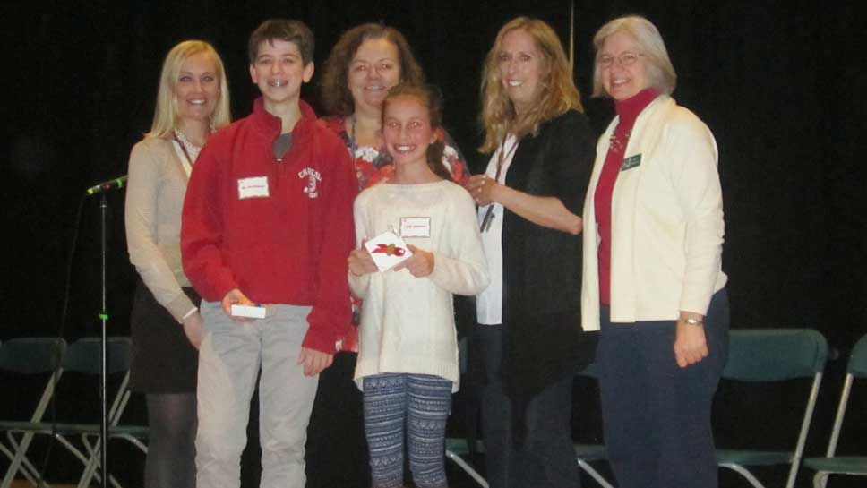 Pictured with Ben and Kitty are the Spelling Bee sponsors (L-R) ​Hannah Tuttle, Jean Hersey, Taylor Monroe, and Leanna Fifhause.