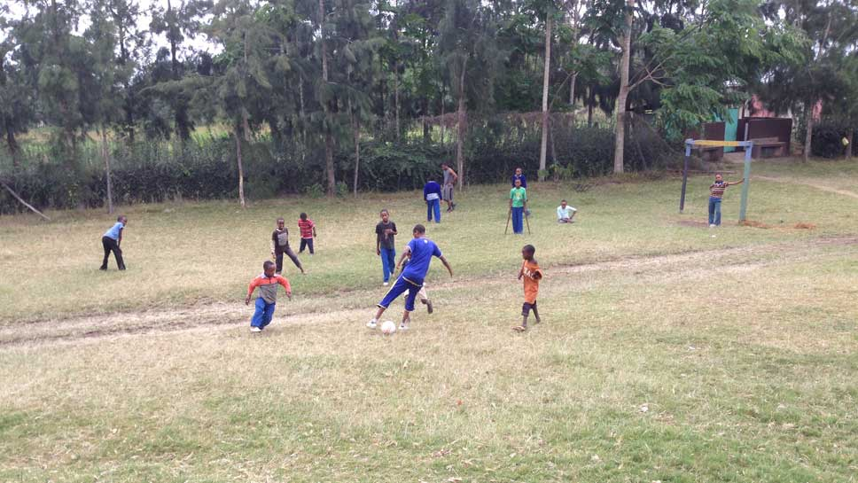 Soccer is big among Faraja students, no matter what their physical capabilities. Here in an informal game, a player puts on a move against an opponent.