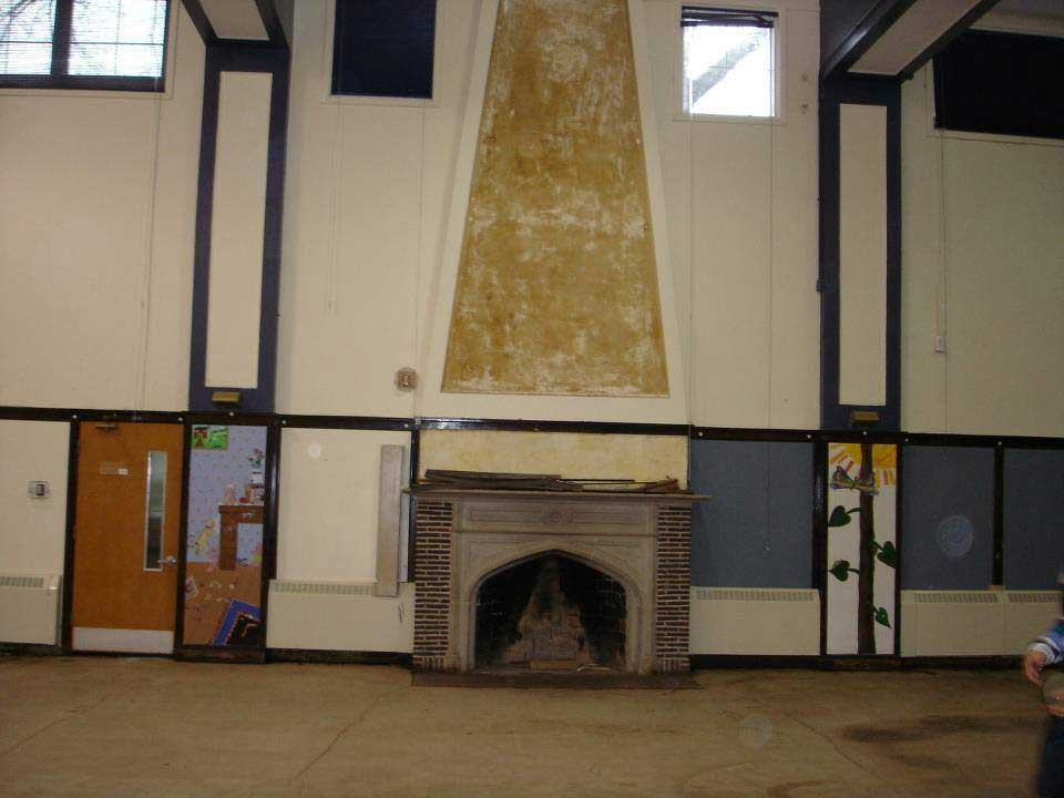 The wall above the fireplace after the mural was removed; photo by Wayne English