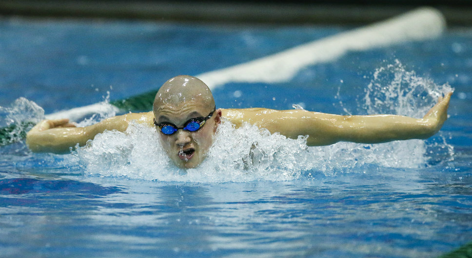 Glenbrook South's Sam Iida drives to a second-place finish in the 200 IM (1:50.91). He also took first in the 500 free (4:31.13). Photography by Joel Lerner