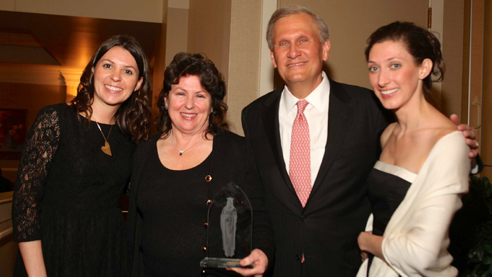 Northbrook residents Betty and Bob Parkinson, pictured with their two daughters Erin '00 and Becky '03, received the Regina Caeli Award, which recognizes outstanding members of the school community.