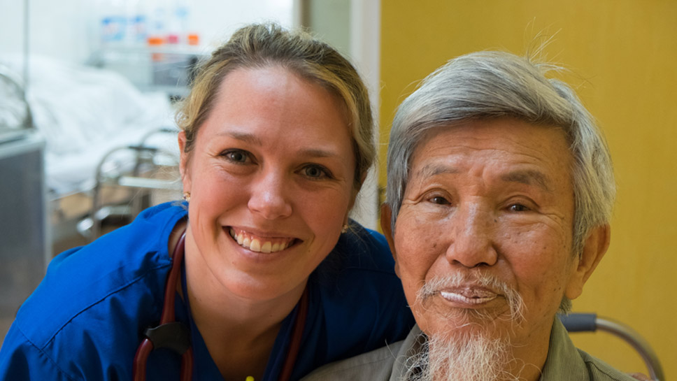 Heather McKinley, a NorthShore University Health System orthopaedic physician assistant, spends time with a grateful patient in Vietnam who was once suspicious of Americans.