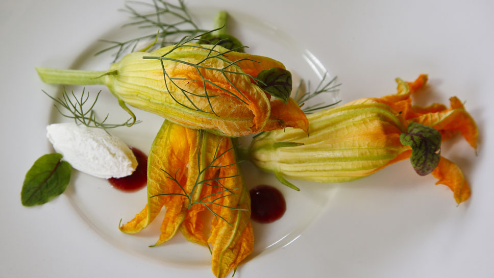 Restaurant Michael's Chicken Truffle Squash Blossoms show the owner's creativity at work.