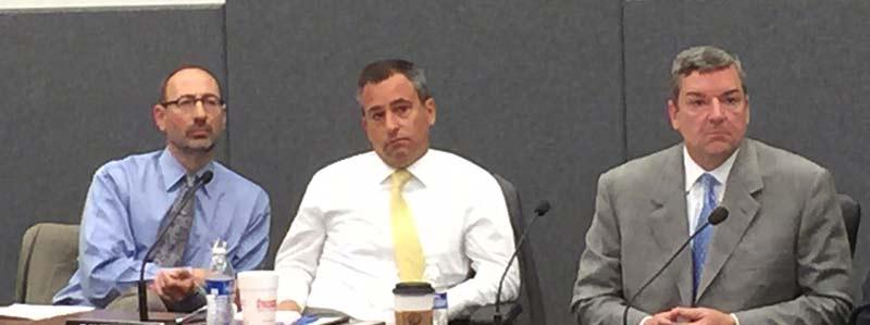 Superintendent Michael Simek at left, with board members David Lane and John Powers.