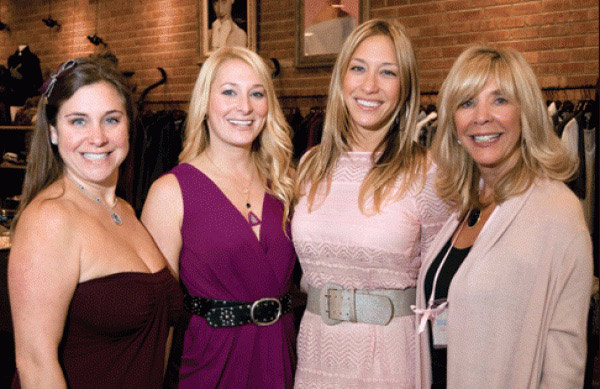 Sisters Melinda Kaplan, Samantha Shapiro, and Lena Blitstein with their mother, Susan Lurie, in 2010 at the Northfield ENAZ for Life store grand opening benefiting the Lynn Sage Cancer Research Foundation.
