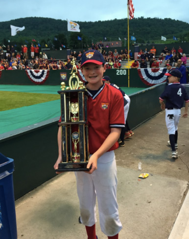 William Rourke poses with the prestigious Golden Arm Trophy after taking first place in Cooperstown, New York.
