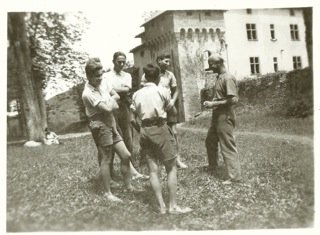 A group of older boys at the Château de La Hille in 1941 shortly before Reed (far left, arms folded) was able to leave for the USA.