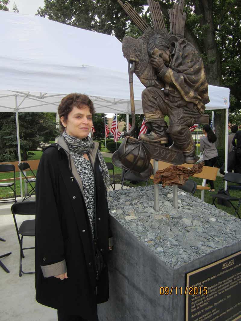 Artist Julie Rotblatt Amrany with sculpture