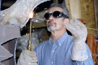 Bill Goldman at work in his studio; photo from his website, www.williamgoldman.com