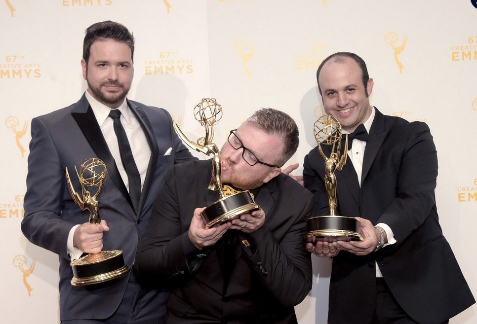 Alexander Rubinow (right) poses with his Emmy alongside colleagues Alex Durham and Josh Earl.