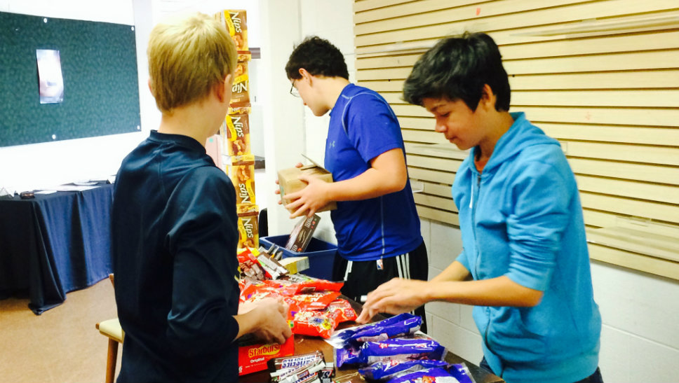 Helping out during the Deer Path Middle School Community Service Day sorting candy at the Citadel Theater are (from left) Will Dee, Evan Jasica and Billy Gardner.