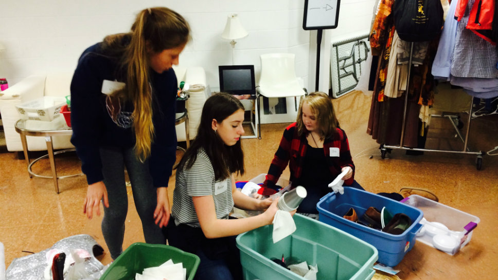 Sorting shoes and props at the Citadel Theater as part of the Deer Path Middle School Community Service Day are (from left) Ashlyn Bloom, Olivia Moe and Lilia Simeck.
