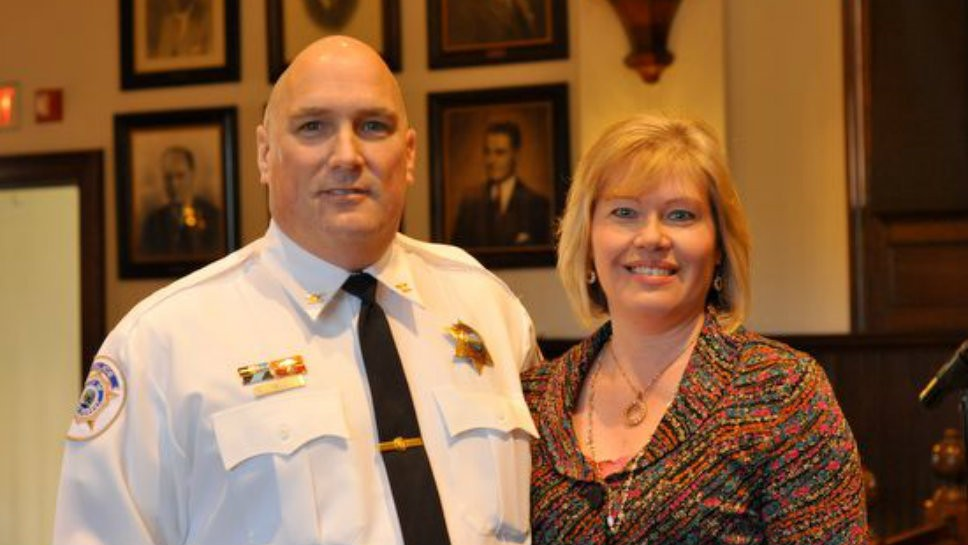 Lake Forest Police Chief Jim Held stands with his wife, Kelly Held.