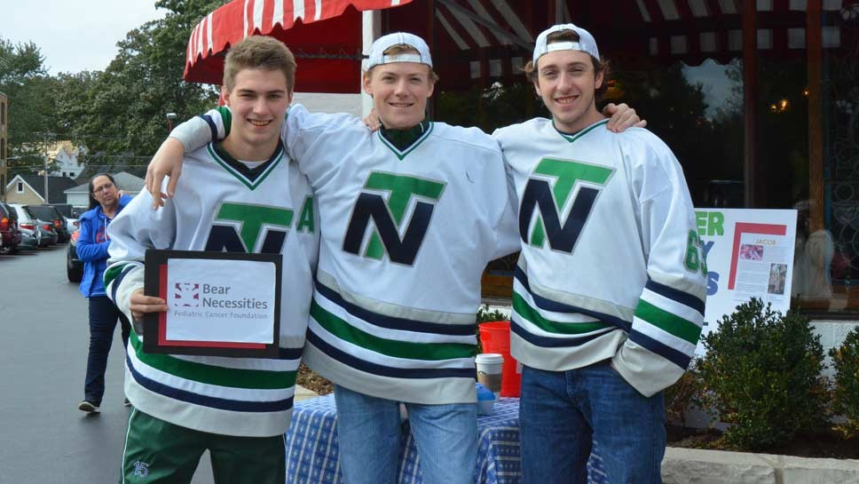 New Trier Hockey Club players took to the streets on Saturday to raise money for Bear Necessities