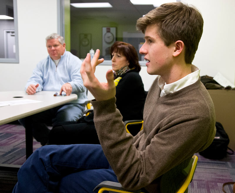 Lake Forest HS senior William Curtiss talks about business High School Hired as the investors, Sally Selzer and Mark Allen look on.  Photography by Joel Lerner/JWC Media