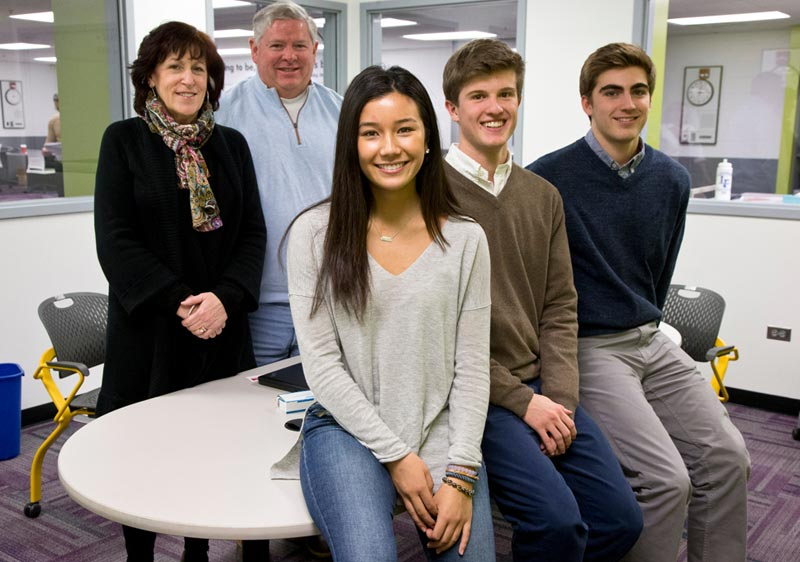 Lake Forest HS seniors Maikal Yamauchi, William Curtiss and Luke Bauder have created the business High School Hired, helping local businesses place high school students in jobs.  Their investors, Sally Selzer and Mark Allen stand to the left.  Photography by Joel Lerner/JWC