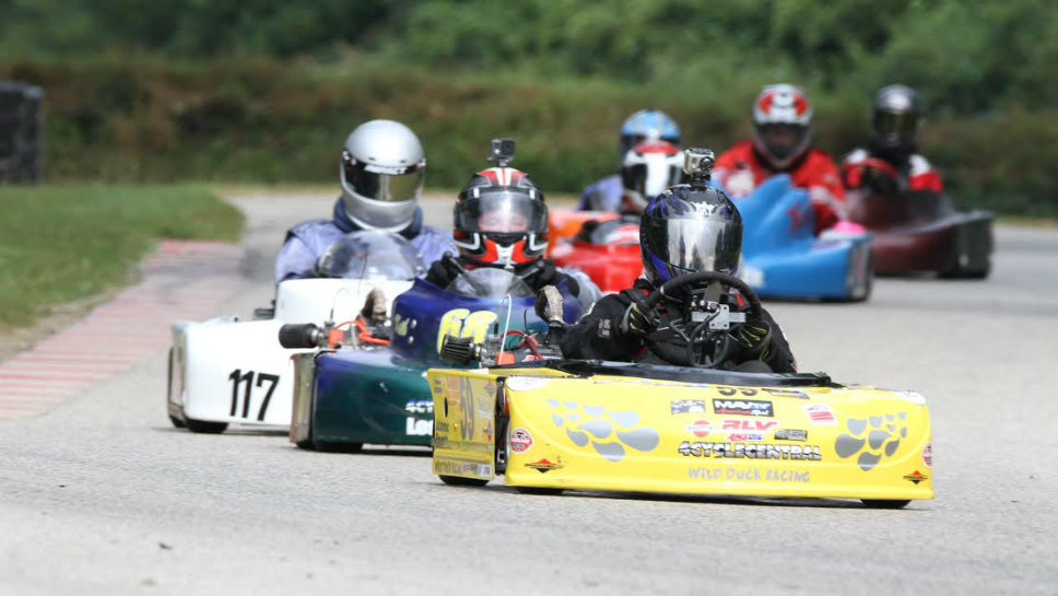 Driving the yellow car, Jason Pribyl of Glenview leads a Go-Kart Race. Photo courtesy of Steve Pribyl.