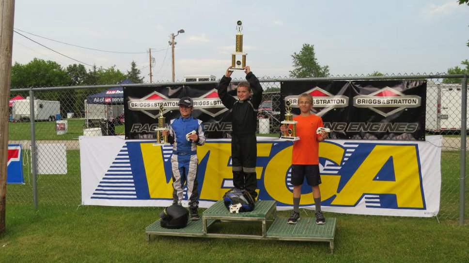 Jason Pribyl holds the trophy he earned winning the 206 Cup. Photo courtesy of Steve Pribyl.