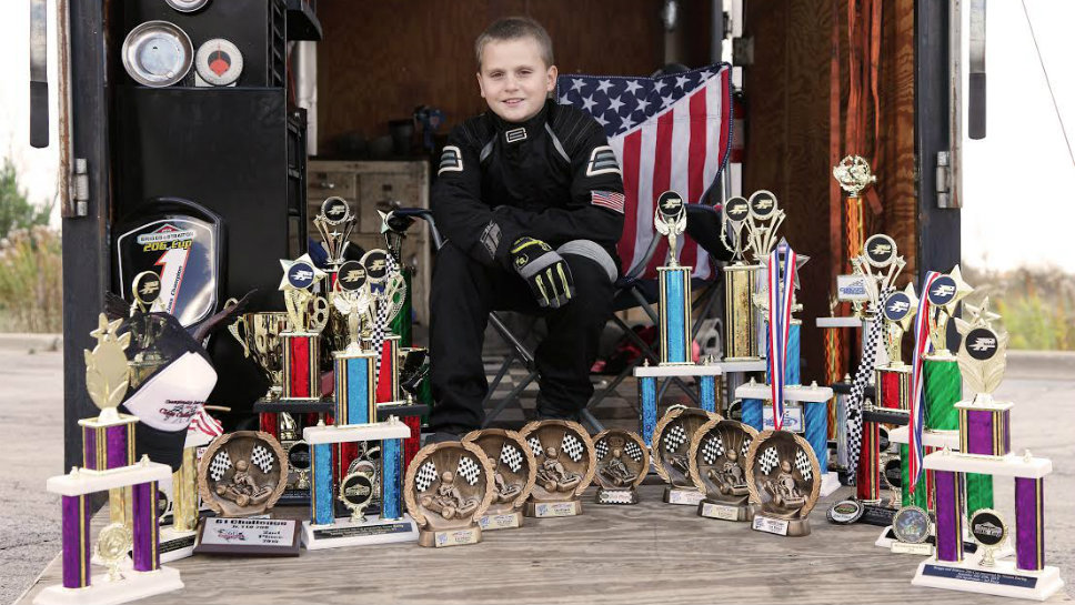 Jason Pribyl looks at his trophies at the end of the 2015 season. Photo courtesy of Steve Pribyl.