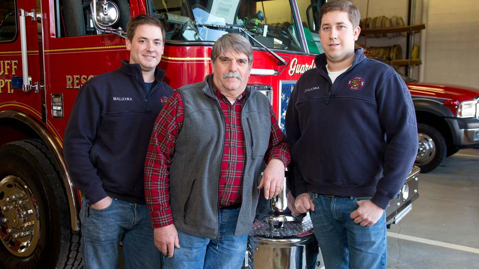 Lake Bluff resident and longtime volunteer firefighter Jerry Kluchka with two of his full-time firefighter sons, Matt Kluchka, (left) of the Lake Forest fire department and Tim Kluchka of the North Chicago fire department. Photography by Joel Lerner/JWC Media