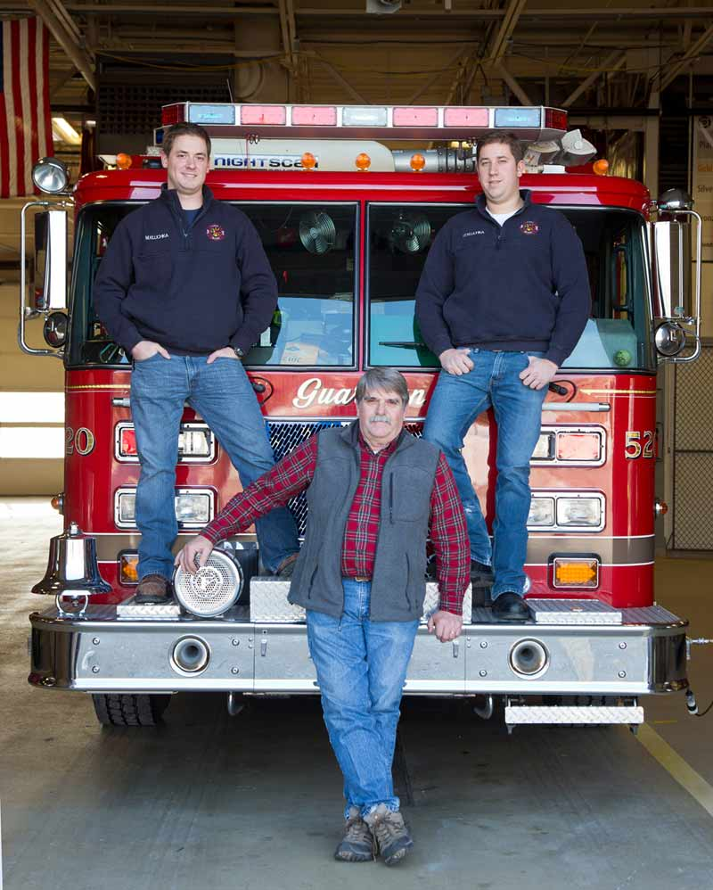 Lake Bluff resident and longtime volunteer firefighter Jerry Kluchka with two of his full-time firefighter sons, Matt Kluchka, (left) of the Lake Forest fire department and Tim Kluchka of the North Chicago fire department. (Their brother Russell is not in the picture.) Photography by Joel Lerner/JWC Media