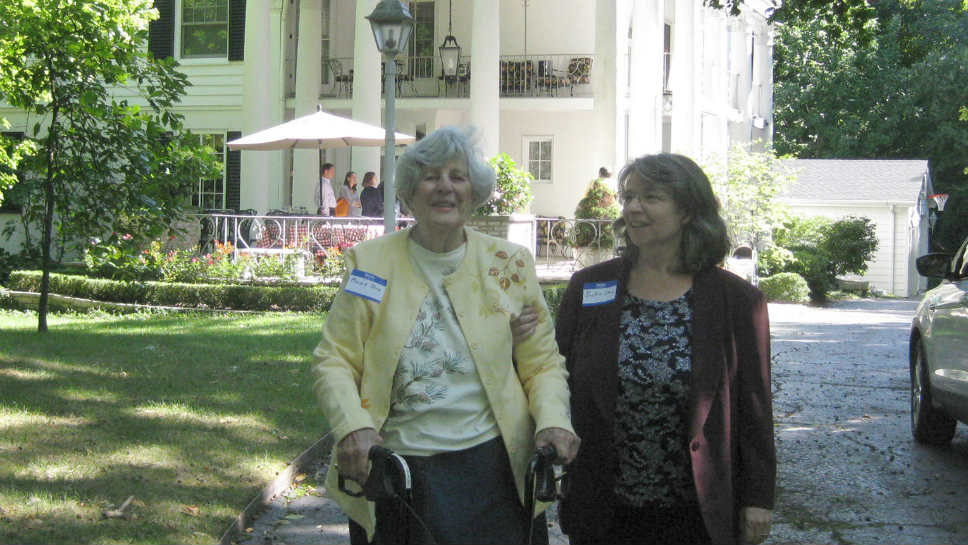 Marion Stern with her daughter outside Oscar Foreman's former home in 2012; photo courtesy of Elliott Miller