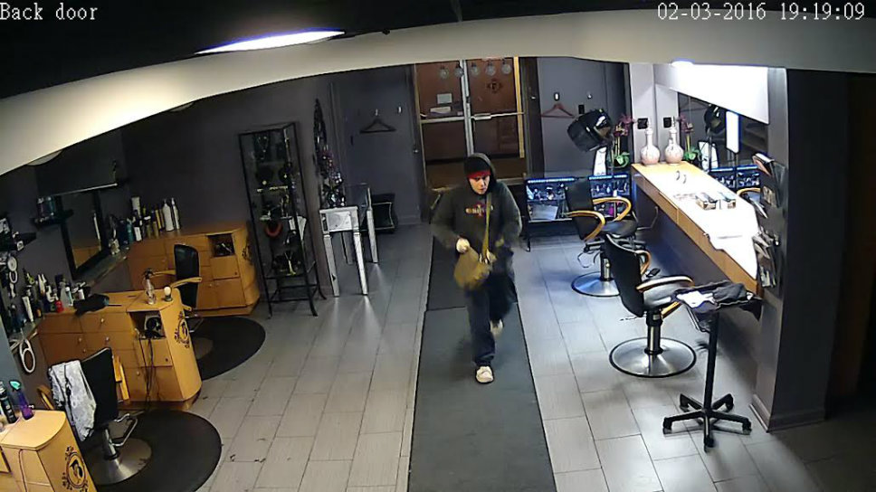 One of the suspects walks through a Highland Park salon. Photo courtesy of the Northbrook Police Department.