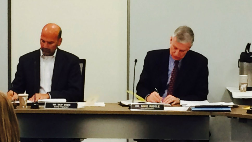 Glenbrook High School District 225 Board of Education President Skip Schein (left) and Superintendent Michael Riggle take part in a board meeting.