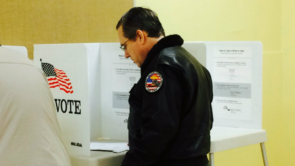 Sen. Mark Kirk (R-Highland Park) votes in Highwood during the March 15 primary.