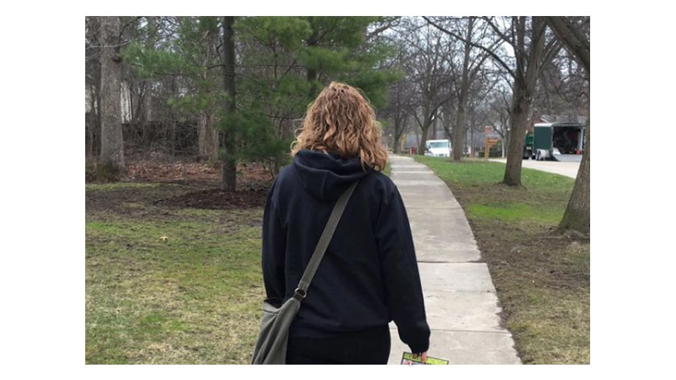A member of the group that was distributing fliers on front doors in Lake Forest on March 29 and 30. Photo from the organization's Twitter feed.