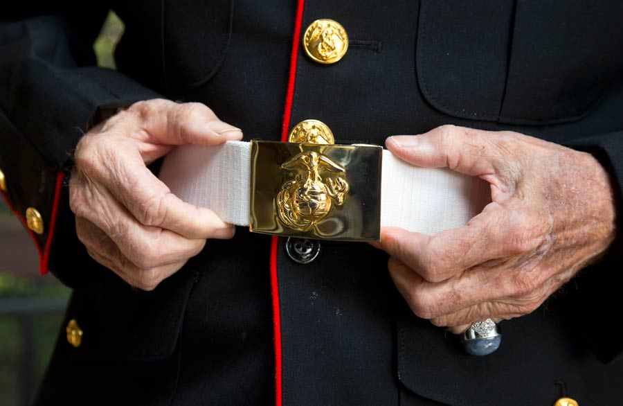 89-year-old Highland Park resident and World War II veteran Larry Klairmont straightens the belt on his Marine uniform. Photography by Joel Lerner/JWC Media