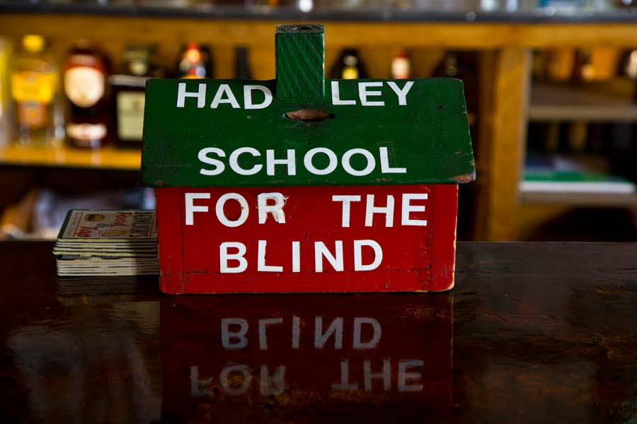 The restaurant/tavern has collected for Hadley School for the Blind, for a long time.