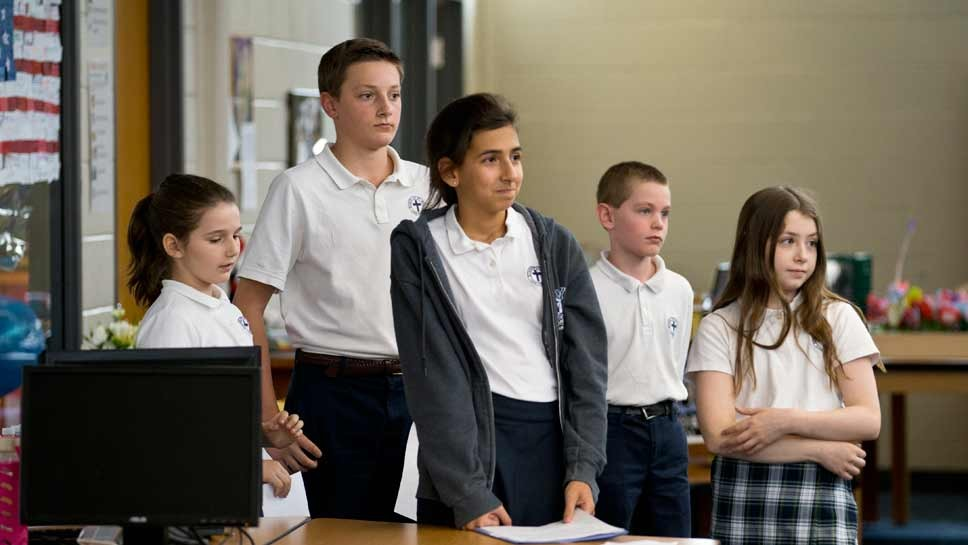 St. Mary's students (left to right) Abby Pace, 5th grade, John Rosinski, 7th grade, Michaela DiVito, 8th grade, Colin Blocki, 4th grade and Abby Cichocki, 6th grade wait to share why the lb is important to them at the blessing of the new Edith Kapoor S.T.E.A.M. Lab at St. Mary's School in Lake Forest. Photography by Joel Lerner/JWC Media
