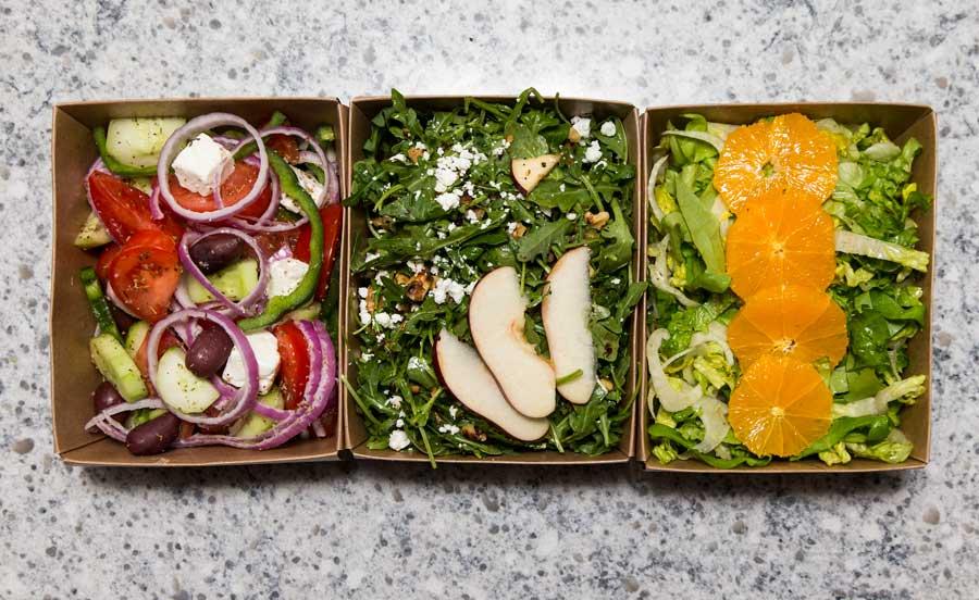 Greek Salad, Arugula Apple Salad and an Orange Salad at Avil in Winnetka. Photography by Joel Lerner/JWC Media