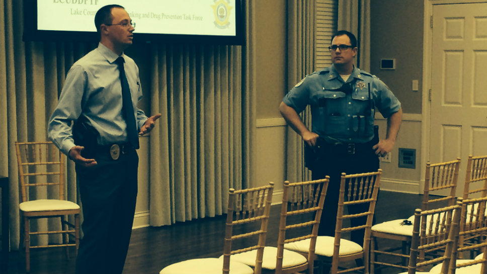 Lake Forest Police Detective Ben Grum (left) and Sgt. Kevin Zelk talk to the group at the Town Hall.