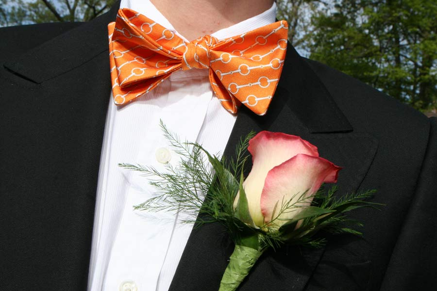 A boutonnière that coordinates with the wearer's bow tie; photo from the JWC Media archives