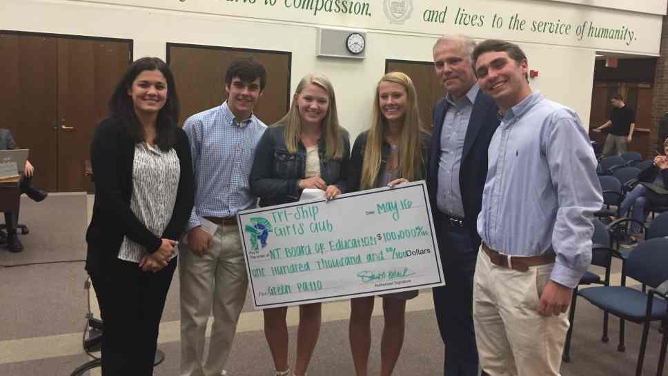 Student leaders of New Trier High School's Tri-Ship and Girls Club, joined by Director of Student Services Athena Arvanitis, present a $100,000 check to New Trier Board of Education President Greg Robitaille to fund a green roof and patio at the Winnetka Campus' new addition. Left to right: Athena Arvanitis, Matt Gallo, Nicole Alston, Kailey Patterson, Greg Robitaille, Jake Paschen.