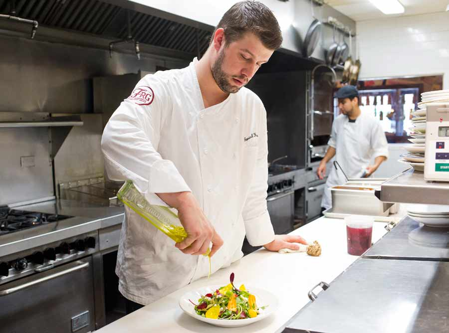 Chef Daniel Harris Puts The Finishing Touches On Farmer S Market Salad With Local Greens