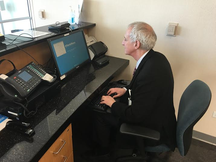 Dr. Benjamin Shain works at his desk. Photo courtesy of NorthShore University HealthSystem.