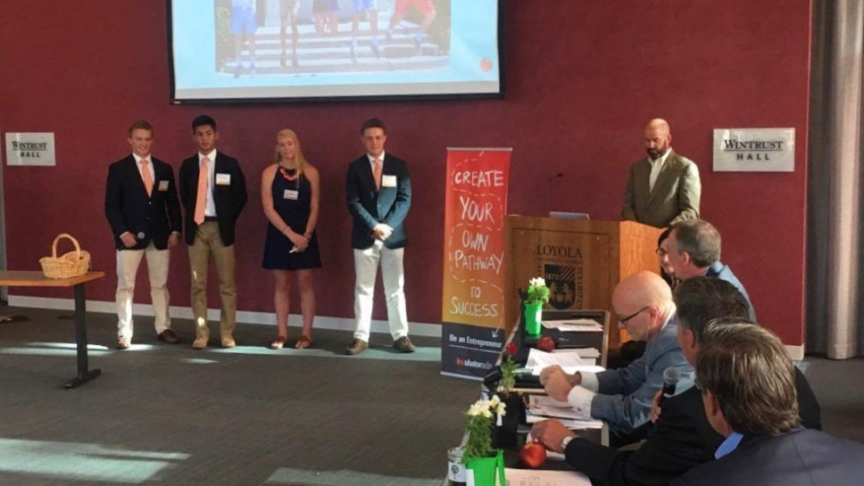 Making their pitch at Loyola University in Chicago are Peach Academics founders (from left) Jon Day, Brandon Rancap, Annabelle Capstick and Leo Spano. Photo courtesy of INCubatoredu.