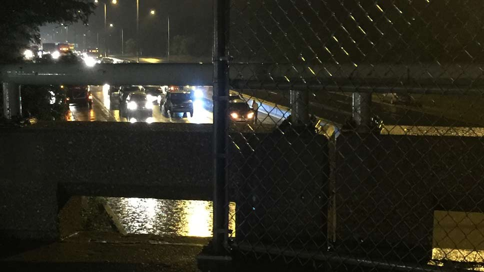 Flooding backed up traffic for miles on I-94 at Winnetka Avenue at about 11:30 p.m. on Saturday, July 23.